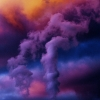 Purple clouds at sunrise near a power station in Australia