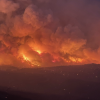 A wildfire rages on a distant hill in Arizona