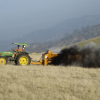 A rancher in Browns Valley, Calif. applies compost to grazed grasslands