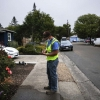 Utility system operator writes a notice to a resident not adhering to water restrictions in Santa Rosa