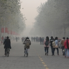 people walking in smoggy air