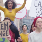 People marching with signs to support climate change action