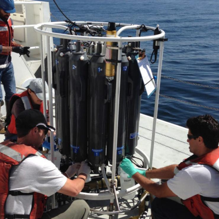 Team members from the Monterey Bay Aquarium Research Institute collect water from Monterey Bay for eDNA analysis.