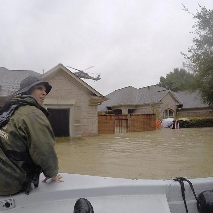 rescuer in boat in Houston flooding