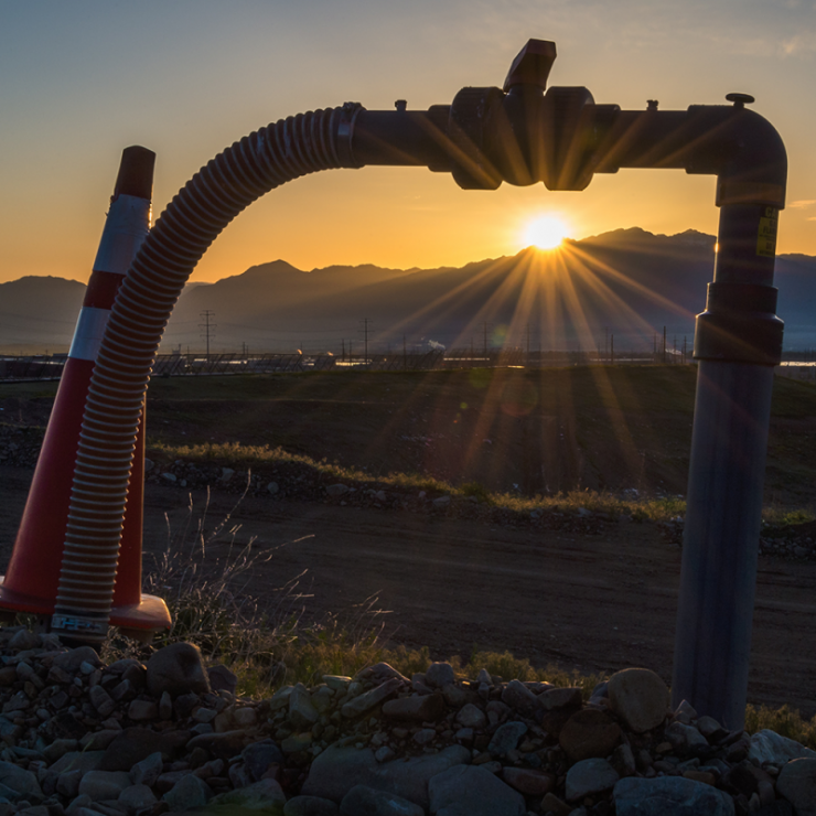 sunrise with a close up of a methane pump