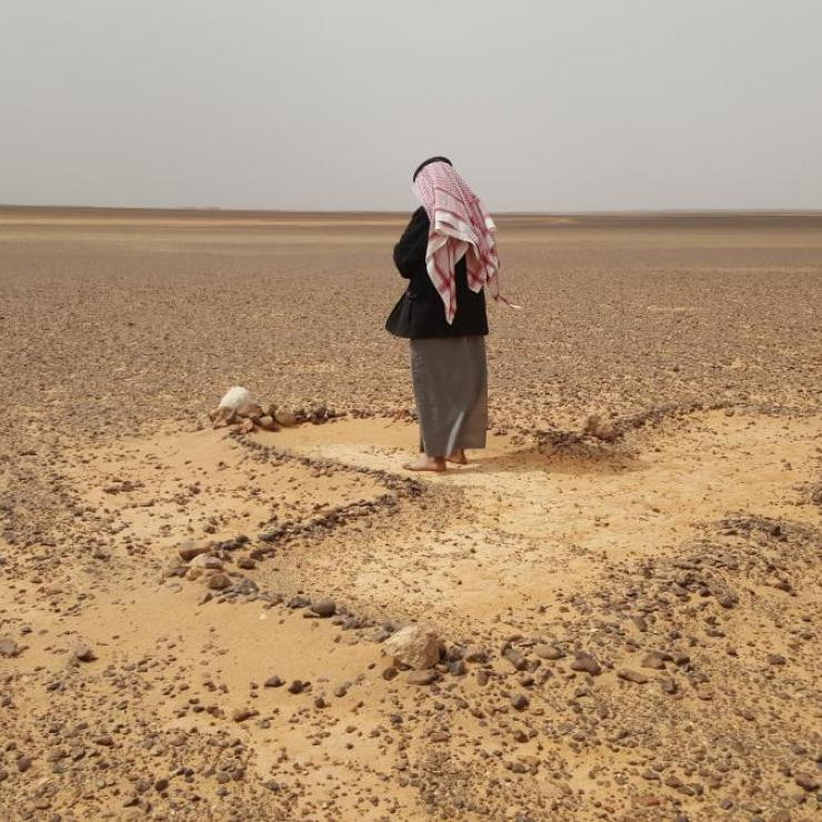 A Bedouin man prays in arid eastern Jordan.
