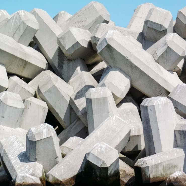cement wave breakers piled to make a seawall