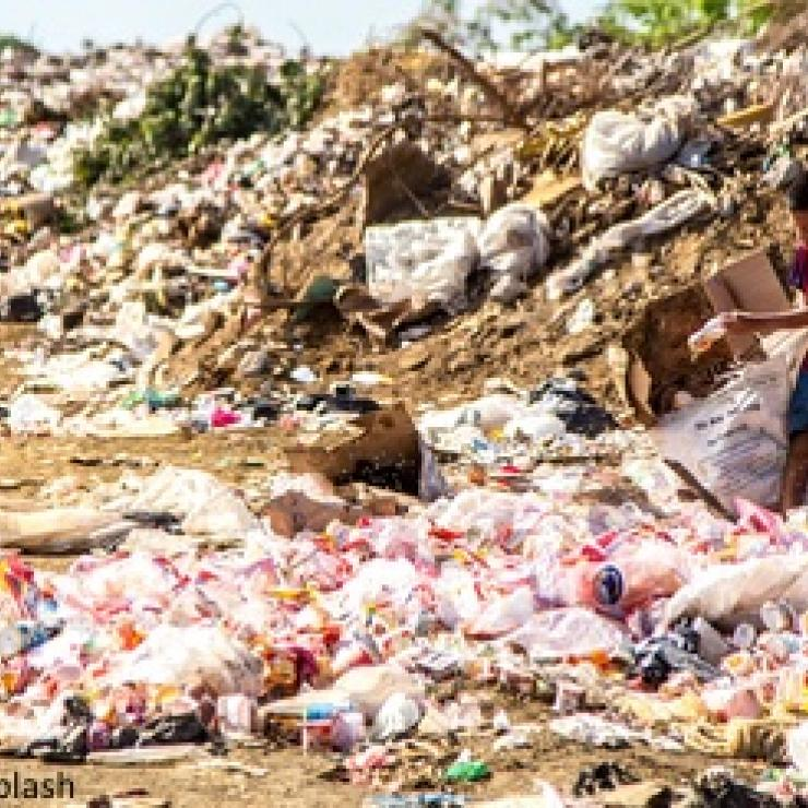 A child sorts through plastic trash in Nicaragua.