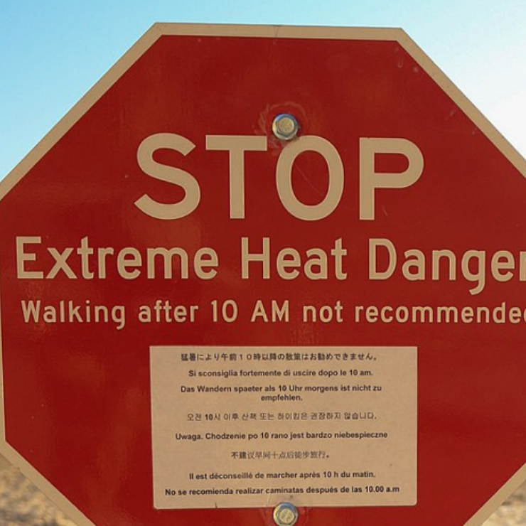 stop sign with warning of extreme heat